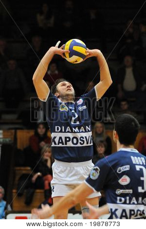 KAPOSVAR, HUNGARY - JANUARY 19: Robert Koch (L) posts the ball at a Hungarian volleyball National Championship game (Kaposvar vs Dunaferr), January 19, 2010 Kaposvar, Hungary.