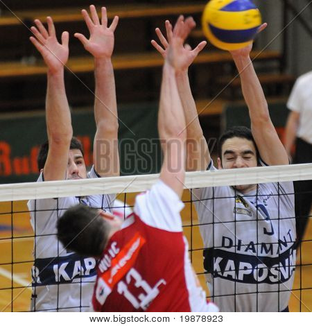 KAPOSVAR, HUNGARY - JANUARY 22: Skoric (L) and Nagy (R) blocks the ball at a Middle European League volleyball game Kaposvar (HUN) vs. HotVolleys Wien (AUT), January 22, 2010 in Kaposvar, Hungary.
