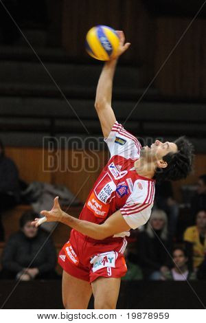 KAPOSVAR, HUNGARY - JANUARY 22: Guilherme serves the ball at a Middle European League volleyball game Kaposvar (HUN) vs. HotVolleys Wien (AUT), January 22, 2010 in Kaposvar, Hungary.