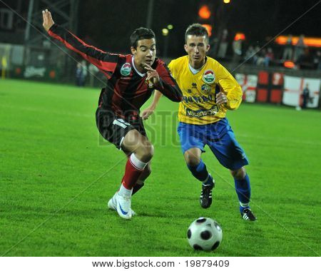 SIOFOK, HUNGARY - OCTOBER 3: Attila Horvath (R) in action at a Hungarian National Championship soccer game Siofok vs. Budapest Honved October 3, 2008 in Siofok, Hungary.