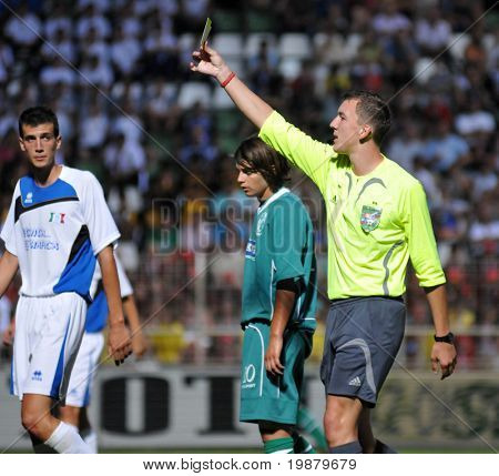 KAPOSVAR, HUNGARY - JULY 20: The referree presents a yellow card at the V. Youth Football Festival U18 opening match - Kaposvar (HUN) vs Brescia (ITA) - July 20, 2009 in Kaposvar, Hungary