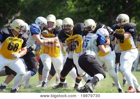 KAPOSVAR, HUNGARY - JUNE 22: Unidentified players in action an american football game Goldenfox vs. Pecs Gringos, June 22, 2008 in Kaposvar, Hungary.