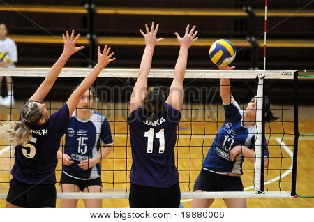 KAPOSVAR, HUNGARY - FEBUARY 19: Gabriella Kondor (R) strikes the ball at the Hungarian NB I. League woman volleyball game Kaposvar vs Ujbuda, February 19, 2010 in Kaposvar, Hungary.