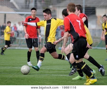 KAPOSVAR, HUNGARY - MARCH 21: Bence Balogh (2nd L) in action at the Hungarian National Championship under 19 game between Kaposvari Rakoczi FC and Pecsi MFC March 21, 2010 in Kaposvar, Hungary.