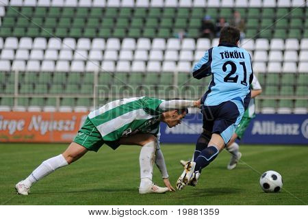 KAPOSVAR, HUNGARY - MARCH 27: Gruz (L) and Tokoli (R) in action at a Hungarian National Championship soccer game Kaposvar vs Paks March 27, 2010 in Kaposvar, Hungary.