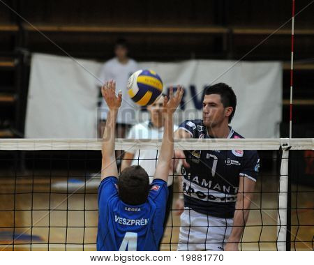 KAPOSVAR, HUNGARY - MARCH 22: Akos Hoboth (R) strikes the ball at a Hungarian National Championship volleyball game Kaposvar vs. Veszprem, March 22, 2010 in Kaposvar, Hungary.