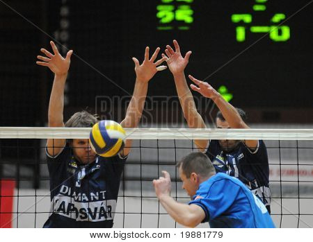 KAPOSVAR, HUNGARY - MARCH 22: Kovacs (L) and Kantor (11) block the ball at a Hungarian National Championship volleyball game Kaposvar vs. Veszprem, March 22, 2010 in Kaposvar, Hungary.