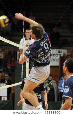 KAPOSVAR, HUNGARY - MARCH 22: Zoltan Kovacs (9) strikes the ball at a Hungarian National Championship volleyball game Kaposvar vs. Veszprem, March 22, 2010 in Kaposvar, Hungary.