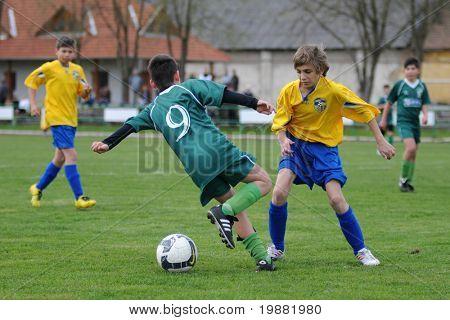 KAPOSVAR, HUNGARY - APRIL 10: Soma Ozorai (C) in action at the Hungarian National Championship under 13 game between Kaposvar and Siofok April 10, 2010 in Kaposvar, Hungary.