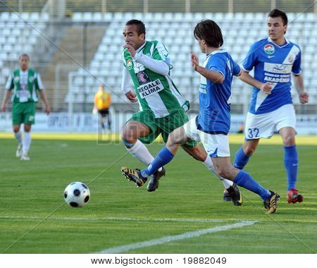 KAPOSVAR, HUNGARY - APRIL 17: Junior Pereira (in green) in action at a Hungarian National Championship soccer game Kaposvar vs MTK Budapest April 17, 2010 in Kaposvar, Hungary.