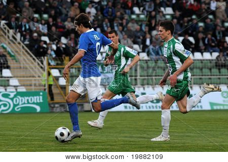 KAPOSVAR, HUNGARY - APRIL 17: Andras Pal (L) in action at a Hungarian National Championship soccer game Kaposvar vs MTK Budapest April 17, 2010 in Kaposvar, Hungary.