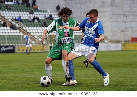 KAPOSVAR, HUNGARY - APRIL 17: Kornel Kulcsar (L) in action at a Hungarian National Championship soccer game Kaposvar vs MTK Budapest April 17, 2010 in Kaposvar, Hungary.