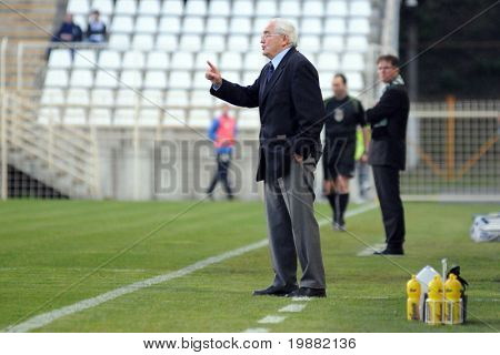 KAPOSVAR, HUNGARY - APRIL 17: Jozsef Garami, MTKâ??s trainer (C) in action at a Hungarian National Championship soccer game Kaposvar vs MTK Budapest April 17, 2010 in Kaposvar, Hungary.
