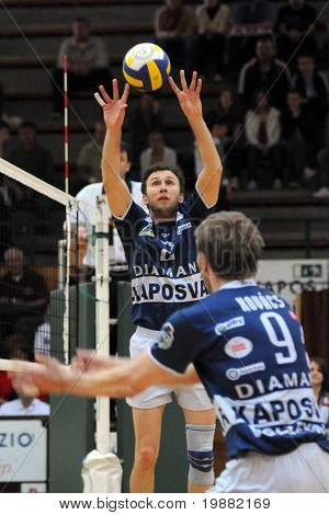 KAPOSVAR, HUNGARY - APRIL 18: Robert Koch (L) posts the ball at a Hungarian National Championship Final volleyball game Kaposvar vs. Kecskemet, April 18, 2010 in Kaposvar, Hungary.