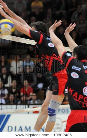 KAPOSVAR, HUNGARY - APRIL 24: Robert Koch (C) blocks the ball at a Hungarian National Championship Final volleyball game Kaposvar vs. Kecskemet, April 24, 2010 in Kaposvar, Hungary.