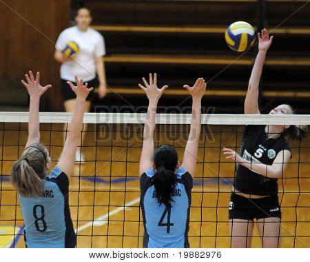 KAPOSVAR, HUNGARY - APRIL 13: T. Kondor (L) and Czmerk (C) blocks the ball at the Hungarian NB I. League woman volleyball game Kaposvar vs Miskolc, April 13, 2010 in Kaposvar, Hungary.