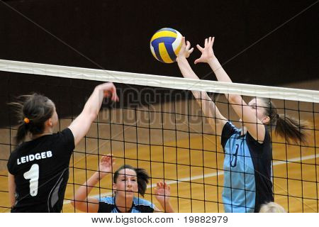 KAPOSVAR, HUNGARY - APRIL 13: Leidgeb (L) and T. Kondor (R) in action at the Hungarian NB I. League woman volleyball game Kaposvar vs Miskolc, April 13, 2010 in Kaposvar, Hungary.