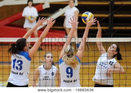 KAPOSVAR, HUNGARY - MARCH 21: Gabriella Kondor (R) strikes the ball at the Hungarian NB I. League woman volleyball game Kaposvar vs. Eger, March 21, 2010 in Kaposvar, Hungary.