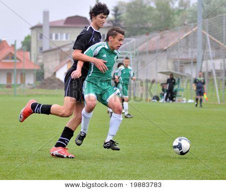 KAPOSVAR, HUNGARY - MAY 15: Bence Kovacs (L) in action at the Hungarian National Championship under 15 game Kaposvari Rakoczi vs. Gyor May 15, 2010 in Kaposvar, Hungary.