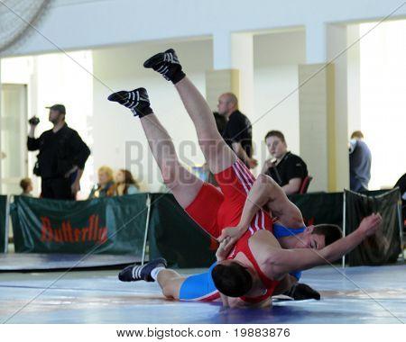 KAPOSVAR, HUNGARY - APRIL 17: Bence Kovacs (in blue) wrestle in the Hungarian Wrestling Cadet National Championship , April 17, 2010 in Kaposvar, Hungary.