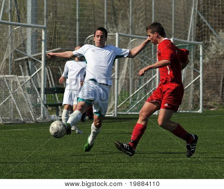 KAPOSVAR, HUNGARY - APRIL 10: Daniel Vaszilko (L) in action at the Hungarian National Championship under 17 game between Rakoczi FC and Debrecen April 10, 2010 in Kaposvar, Hungary.
