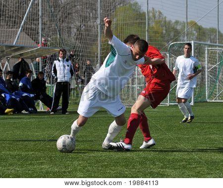 KAPOSVAR, HUNGARY - APRIL 10: Patrik Bojte (L) in action at the Hungarian National Championship under 17 game between Rakoczi FC and Debrecen April 10, 2010 in Kaposvar, Hungary.