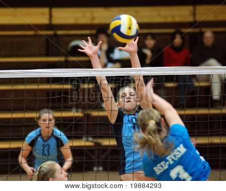 KAPOSVAR, HUNGARY - FEBRUARY 20: Timea Kondor (C) blocks the ball at the Hungarian Cup woman volleyball game Kaposvar vs. BSE, February 20, 2008 in Kaposvar, Hungary.