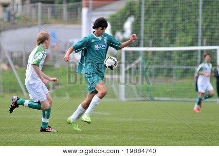 KAPOSVAR, HUNGARY - MAY 29: Bence Kovacs (R) in action at the Hungarian National Championship under 15 game between Kaposvari Rakoczi and Paks May 29, 2010 in Kaposvar, Hungary.