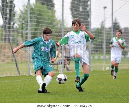 KAPOSVAR, HUNGARY - MAY 29: Attila Kovacs (L) in action at the Hungarian National Championship under 15 game between Kaposvari Rakoczi and Paks May 29, 2010 in Kaposvar, Hungary.