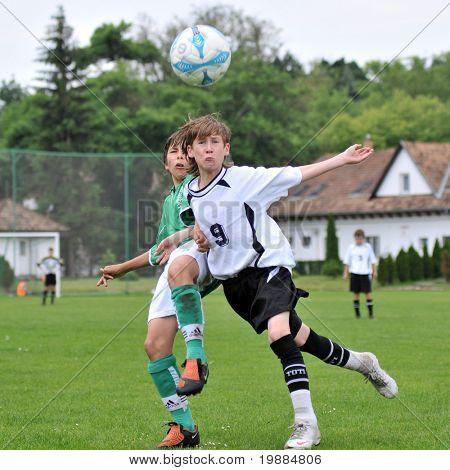 KAPOSVAR, HUNGARY - MAY 29: Armin Prukner (R) in action at the Hungarian National Championship under 13 game between Kaposvari Rakoczi and Paks May 29, 2010 in Kaposvar, Hungary.