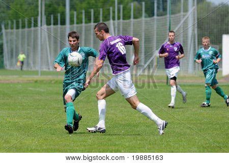KAPOSVAR, HUNGARY - MAY 30: Andras Farkas (16) in action at the Hungarian National Championship under 19 game between Kaposvar and Kecskemet May 30, 2010 in Kaposvar, Hungary.
