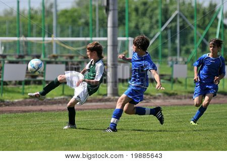 KAPOSVAR, HUNGARY - JUNE 12: Mate Grabarics (L) in action at the Hungarian National Championship under 13 game between Kaposvari Rakoczi and Tatabanya June 12, 2010 in Kaposvar, Hungary.