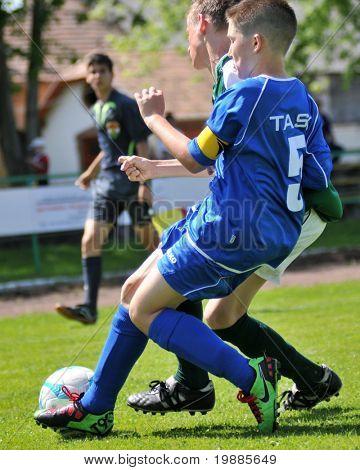 KAPOSVAR, HUNGARY - JUNE 12: Roland Graszner (in blue) in action at the Hungarian National Championship under 13 game between Kaposvari Rakoczi and Tatabanya June 12, 2010 in Kaposvar, Hungary.