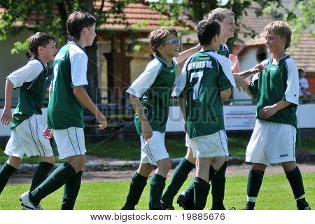 KAPOSVAR, HUNGARY - JUNE 12: Kaposvar players celebrate a goal at the Hungarian National Championship under 13 game between Kaposvari Rakoczi and Tatabanya June 12, 2010 in Kaposvar, Hungary.
