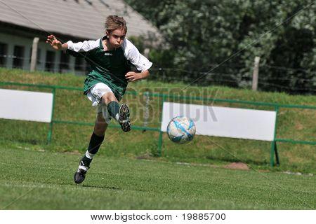 KAPOSVAR, HUNGARY - JUNE 12: Unidentified player in action at the Hungarian National Championship under 13 game between Kaposvari Rakoczi and Tatabanya June 12, 2010 in Kaposvar, Hungary.