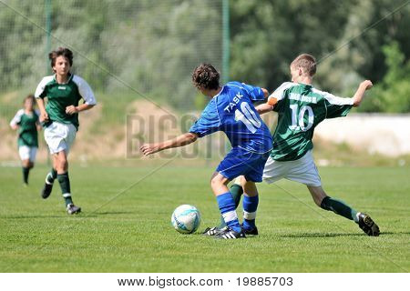 KAPOSVAR, HUNGARY - JUNE 12: Mate Grabarics (R) in action at the Hungarian National Championship under 13 game between Kaposvari Rakoczi and Tatabanya June 12, 2010 in Kaposvar, Hungary.