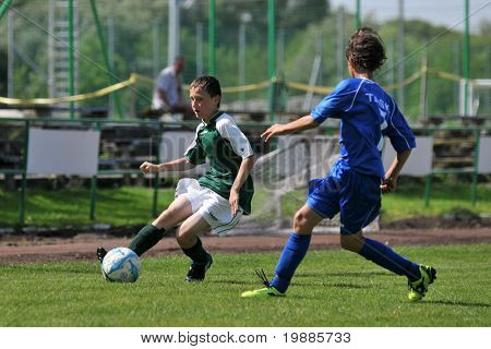 KAPOSVAR, HUNGARY - JUNE 12: Unidentified players in action at the Hungarian National Championship under 13 game between Kaposvari Rakoczi and Tatabanya June 12, 2010 in Kaposvar, Hungary.