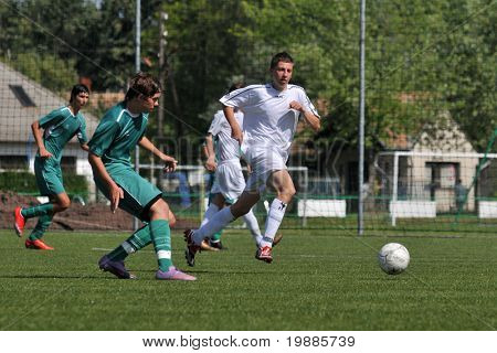 KAPOSVAR, HUNGARY - JUNE 12: Milan Mayer (C) in action at the Hungarian National Championship under 15 game between Kaposvari Rakoczi and Tatabanya June 12, 2010 in Kaposvar, Hungary.