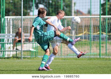 KAPOSVAR, HUNGARY - JUNE 12: Milan Mayer (L) in action at the Hungarian National Championship under 15 game between Kaposvari Rakoczi and Tatabanya June 12, 2010 in Kaposvar, Hungary.