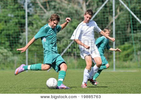 KAPOSVAR, HUNGARY - JUNE 12: Milan Mayer (L) in action at the Hungarian National Championship under 15 game between Kaposvari Rakoczi and Tatabanya June 12, 2010 in Kaposvar, Hungary.