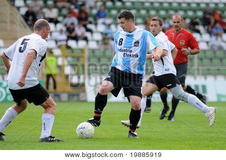 KAPOSVAR, HUNGARY - JUNE 19: Andras Perger (L) in action at a Somogy County Championship II. final game Balatonszabadi vs. Nemesvid - June 19, 2010 in Kaposvar, Hungary.