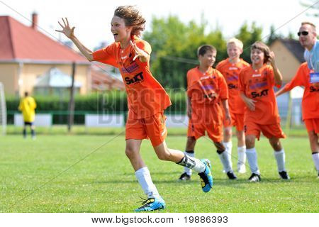 KAPOSVAR, HUNGARY - JULY 19: Slovenian players celebrate the win after  the VI. Youth Football Festival match NK Mengo (SLO) vs. Grund FC (HUN)- July 19, 2010 in Kaposvar, Hungary