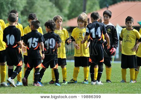 KAPOSVAR, HUNGARY - JULY 19: Competitors shake hands before a VI. Youth Football Festival match Efthymiades FA (CYP) vs. Club Academia Venezolana de Futból (VEN)- July 19, 2010 in Kaposvar, Hungary