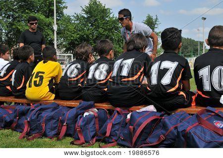 KAPOSVAR, HUNGARY - JULY 19: Venezuelan players listen to their trainer at a VI. Youth Football Festival match Efthymiades FA (CYP) vs. Academia Venezolana (VEN)- July 19, 2010 in Kaposvar, Hungary
