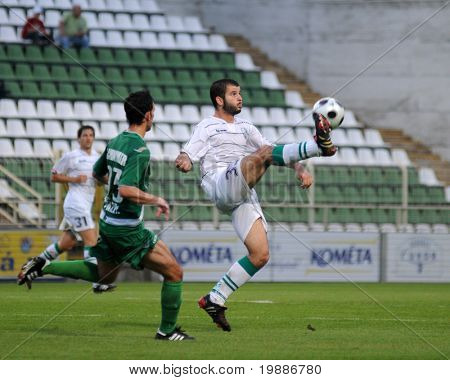 KAPOSVAR, HUNGARY - AUGUST 14: Pedro Sass (R) in action at a Hungarian National Championship soccer game Kaposvar vs. Haladas August 14, 2010 in Kaposvar, Hungary.