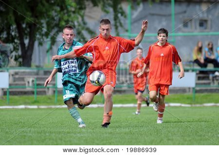 KAPOSVAR, HUNGARY - AUGUST 29: Patrik Stangli (L) in action at the Hungarian National Championship under 19 game between Kaposvari Rakoczi and Bonyhad August 29, 2010 in Kaposvar, Hungary.