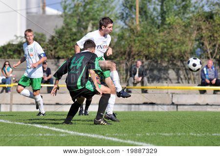 KAPOSVAR, HUNGARY - SEPTEMBER 5: Unidentified players in action at a Hungarian National Championship III. soccer game Kaposvar II. vs. Nagyatad September 5, 2010 in Kaposvar, Hungary.