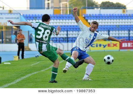 OSIJEK, CROATIA - JULY 2: Andras Gardos (L) in action at a friendly soccer game Osijek (CRO) vs. Ferencvaros (HUN) - July 2, 2010 in Osijek, Croatia.