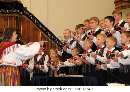 KAPOSVAR, HUNGARY - AUGUST 26: Members of the Suae Music School Choir (EST) sing at the IV. Pannonia Cantat Youth Choir Festival August 26, 2010 in Kaposvar, Hungary
