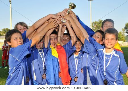 KAPOSVAR, HUNGARY - JULY 23: Romanian players celebrate after the VI. Youth Football Festival Under 11 Final FK Novi Grad (BOS) vs. Atletico Rosiori (ROM) July 23, 2010 in Kaposvar, Hungary